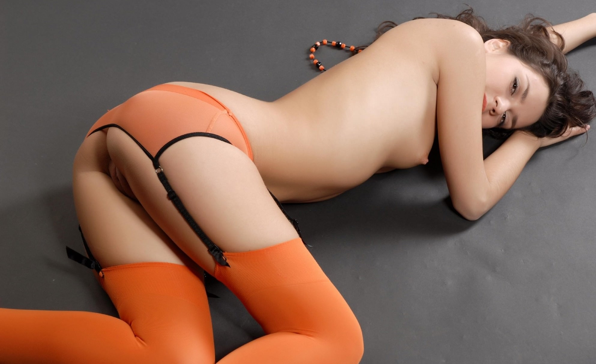 Naked women in striped thigh socks