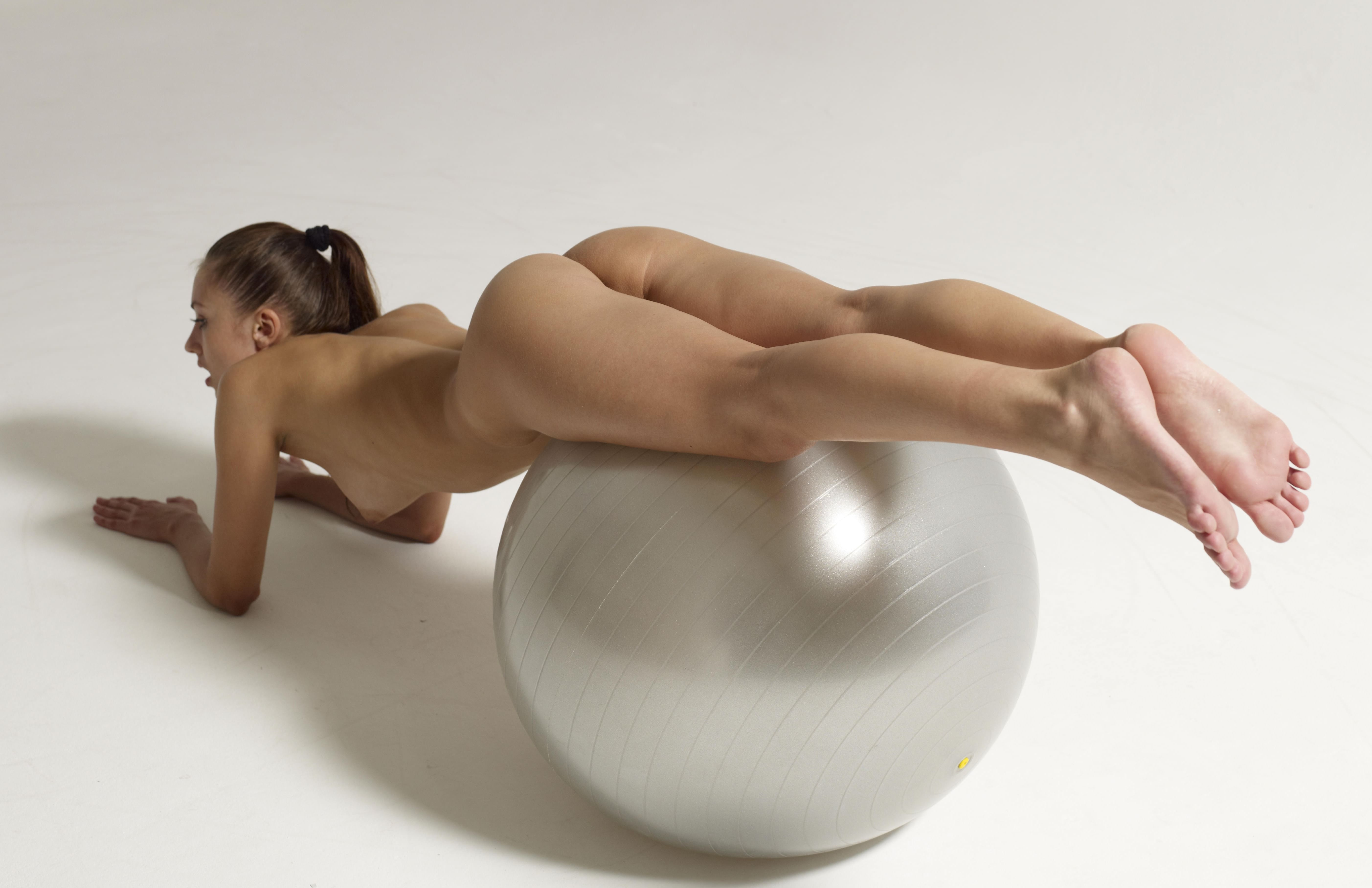 Nude girl curled up in a ball
