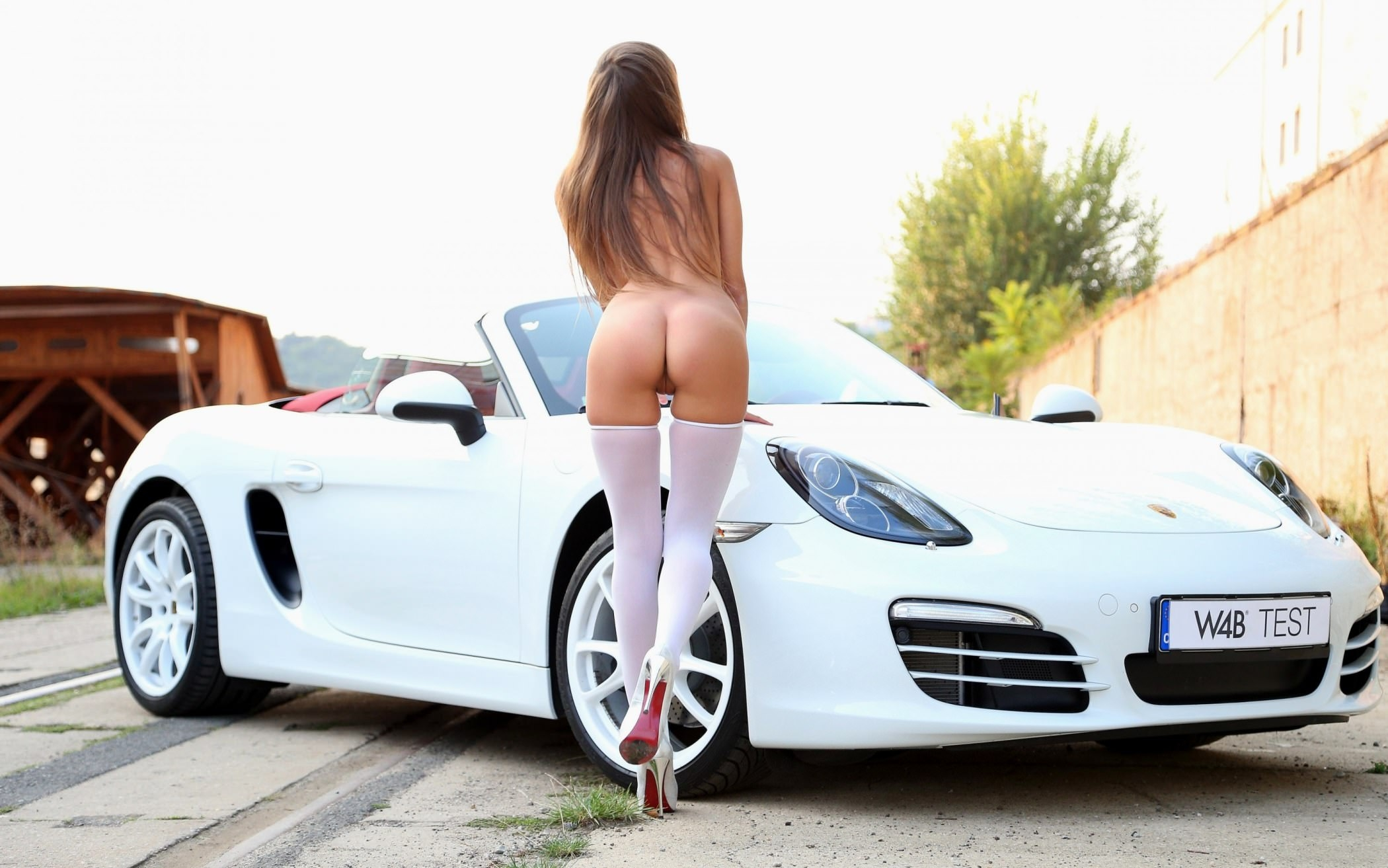 Nude girls on sports cars