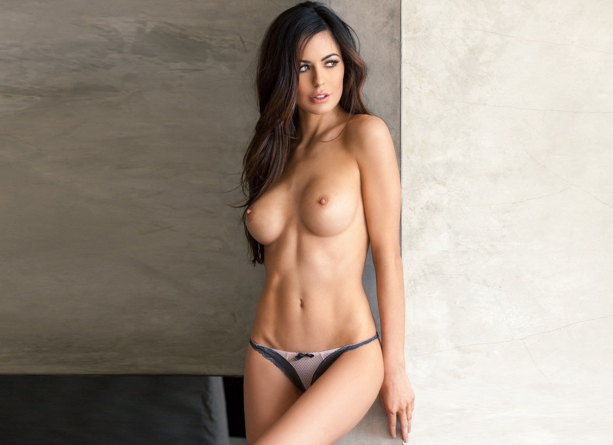Beautiful brunette girl fashion model with naked shoulders and w stock image