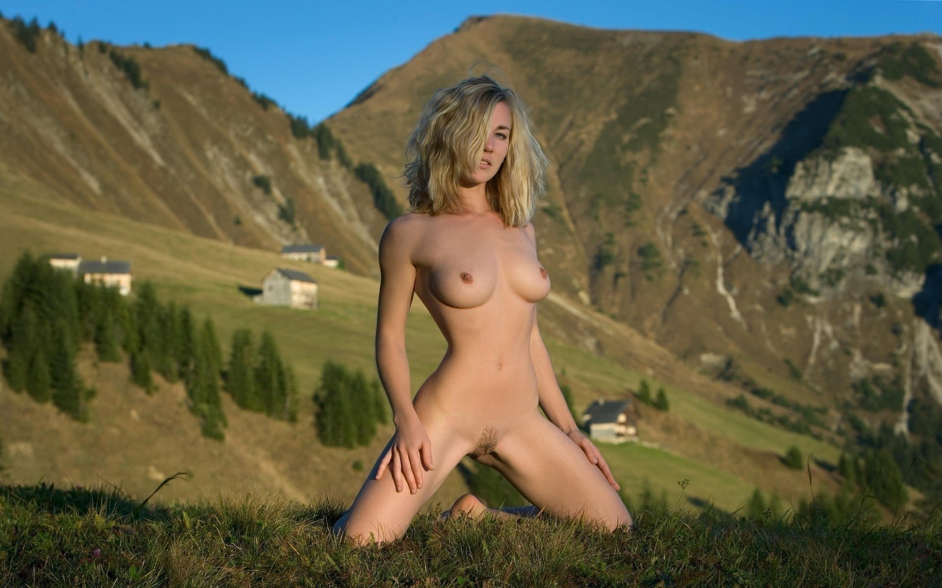 Sexy nude girl overlooking the valley