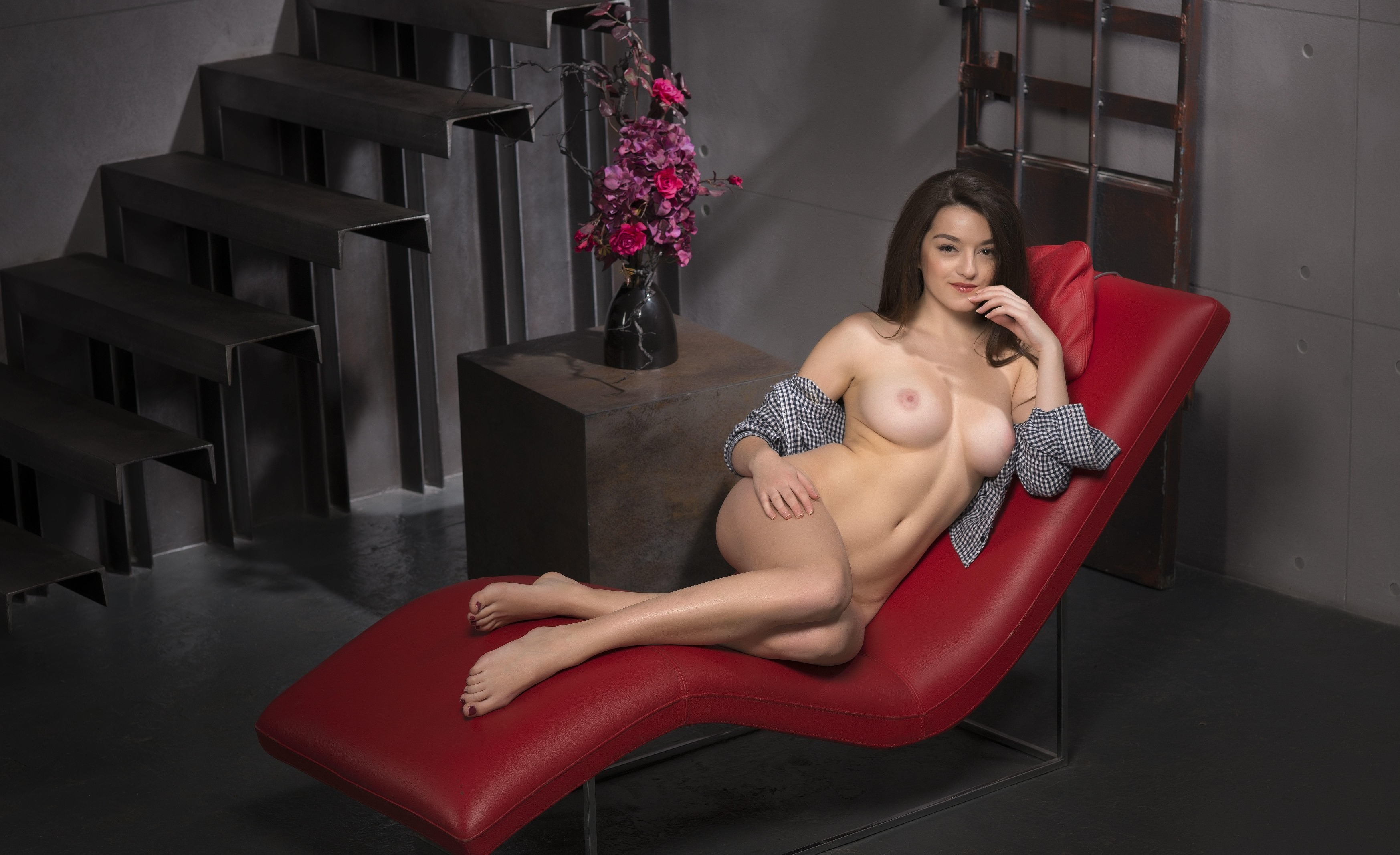 Leah gotti spreads in a lounge chair