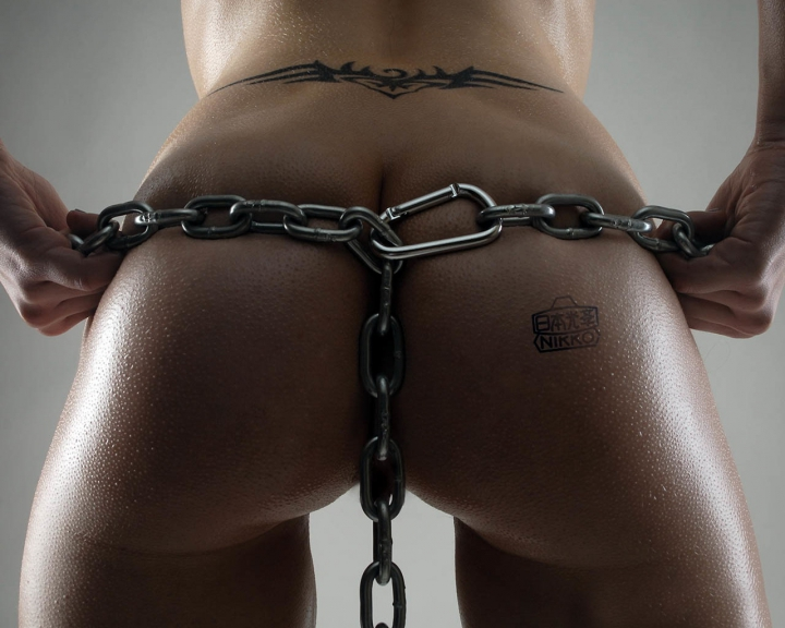 Chain on buttocks, tattoo, wet ass, gray background, ass glitters